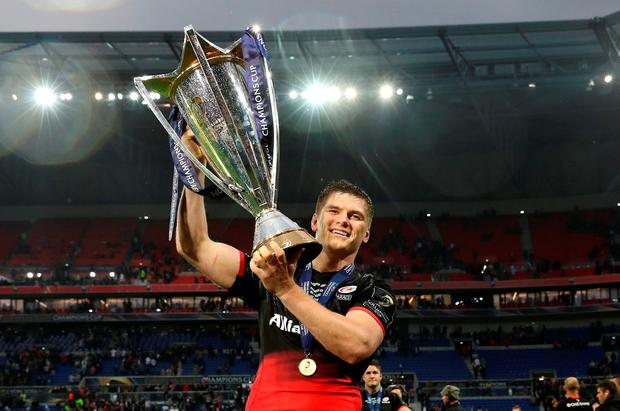 Owen Farrell lifts the Champions Cup trophy aloft. Photo: Getty