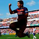Barcelona's Luis Suarez celebrates his second goal. Pictures: Marcelo Del Pozo/Reuters