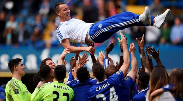 Chelsea's John Terry is thrown in the air by team mates after the game against Leicester City. Photo: Tony O'Brien/Reuters