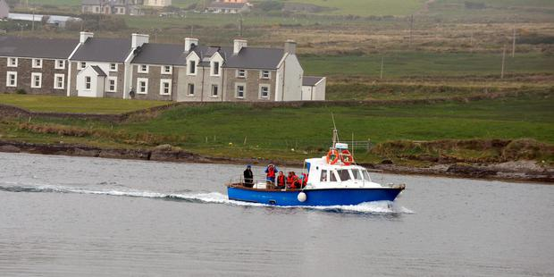 Boats full with tourists arrive back in Portmagee after visiting Skellig Michael on Sunday. Photo: Don MacMonagle