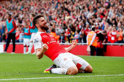 Olivier Giroud celebrates after scoring the second goal for Arsenal. Photo: Stefan Wermuth/Reuter