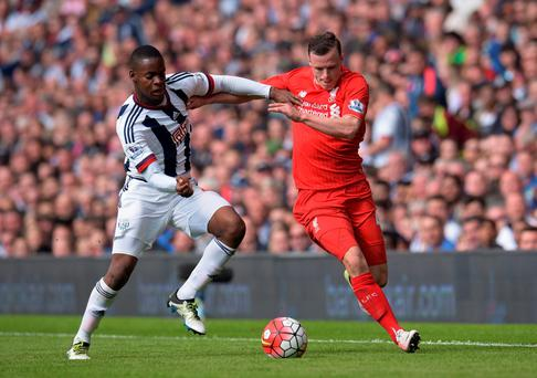 Liverpool's Brad Smith and West Brom's Jonathan Leko battle for the ball. Photo:Paul Burrows/Reuters