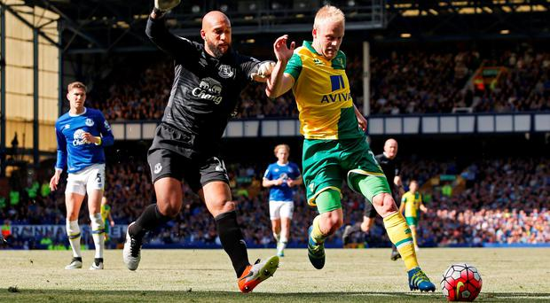 Everton's Tim Howard in action with Norwich's Steven Naismith at Goodison Park. Photo: Ed Sykes/Reuters