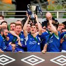 Crumlin United captain James Lee lifts the cup after winning the FAI Intermediate Cup final on Saturday. Photo: Sportsfile