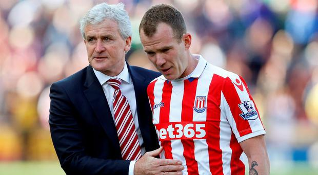 Stoke manager Mark Hughes with Glenn Whelan after the match at The Britannia Stadium. Photo: Phil Noble/Reuters