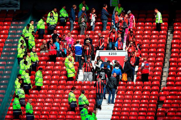 Fans are evacuated from Old Trafford as the match is abandoned. Photo: Getty