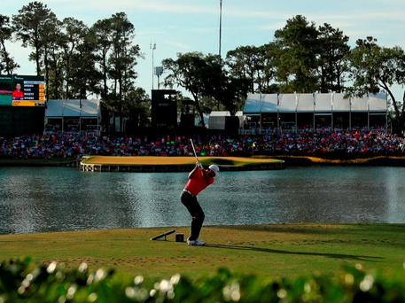 Jason Day plays his shot from the 17th tee on his way to victory at the The Players Championship. Photo: Getty