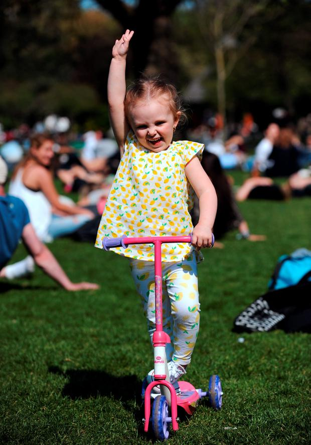 Beau Byrne, 4, from Crumlin, Dublin, enjoying the sunshine. St. Stephen's Green, Dublin. Picture: Caroline Quinn