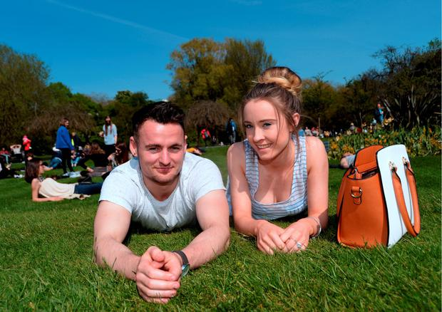 Dylan Croke, from Tallaght, and Sara OConnor, from Clondalkin, enjoying the sunshine. St. Stephen's Green, Dublin. Picture: Caroline Quinn