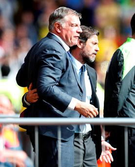 Sunderland manager Sam Allardyce and Watford manager Quique Sanchez Flores react to Troy Deeney's goal from a penalty during the Barclays Premier League match at Vicarage Road yesterday