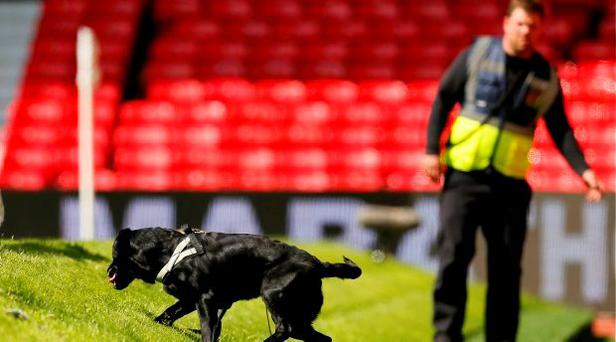 Police use sniffer dogs as fans are evacuated from the stadium as the match is abandoned Action Images via Reuters / Jason Cairnduff