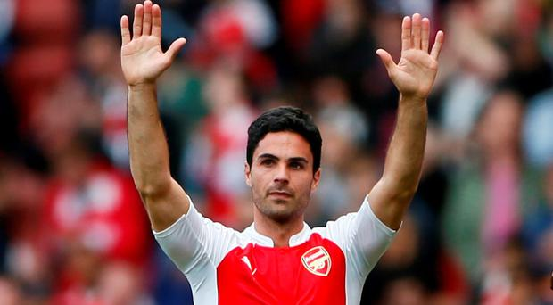 Arsenal's Mikel Arteta gestures to the fans at the end of the match Reuters / Stefan Wermuth