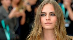 Cara Delevingne attends the Burberry Prorsum show during London Fashion Week Spring/Summer 2016/17 on September 21, 2015 in London, England. (Photo by Anthony Harvey/Getty Images)