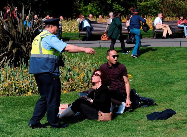 OPW worker moving people off grass who were enjoying the sunshine. St. Stephen's Green, Dublin. Picture: Caroline Quinn