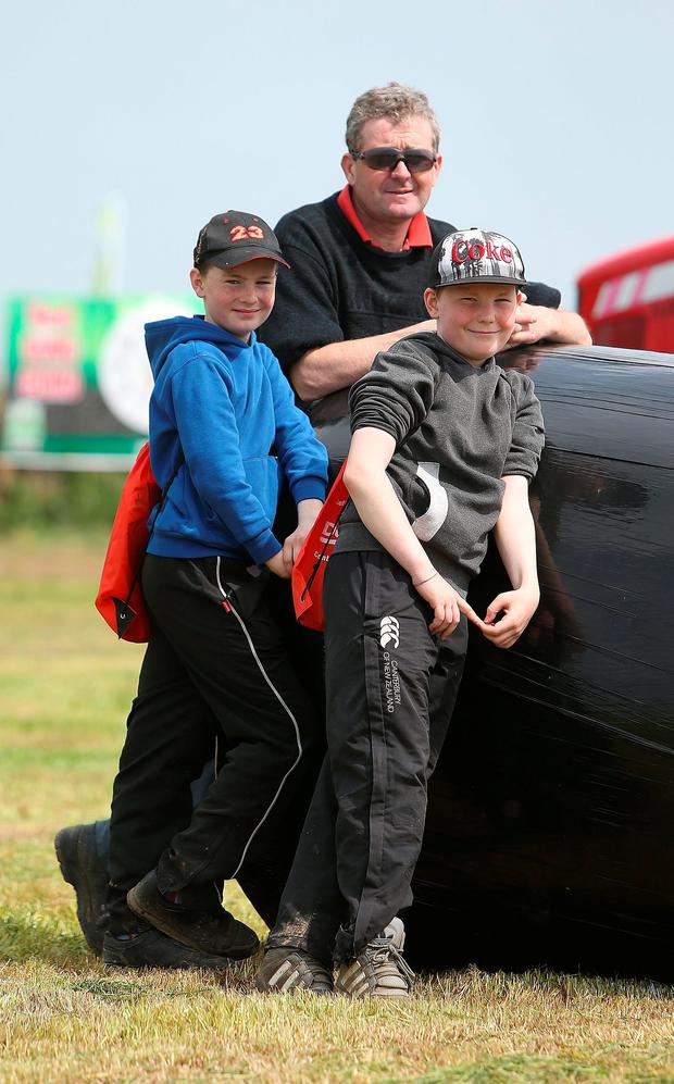 Gerry Cosgrove, and his sons Daniel (12) and Cian (11) from Balinasloe, Galway at The FTMTA Grass & Muck Show 2016 at Gurteen College, Tipperary. Photo: Damien Eagers.