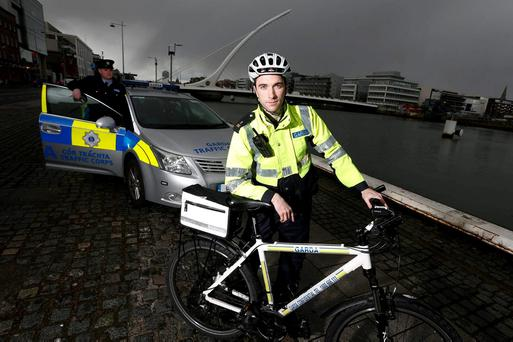 Garda Noel Gibbons and Garda John Donnelly on patrol on Dublin's quays in new RTE series 'Guards'. Picture Conor McCabe Photography