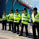 Police on duty outside Old Trafford after the evacuation.