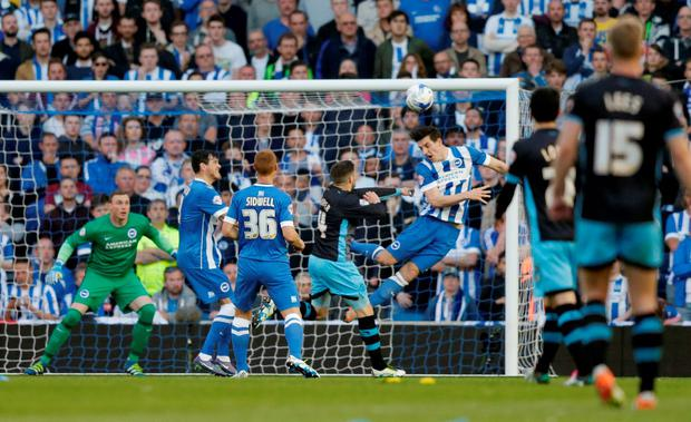 Brighton's Lewis Dunk appears to be pushed by Sheffield Wednesday's Gary Hooper as Ross Wallace (not pictured) scores the first goal for Wednesday Photo: Reuters / Henry Browne