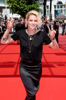 Actress Kristen Stewart poses for photographers upon arrival at the screening of the film American Honey at the 69th international film festival, Cannes, southern France, Sunday, May 15, 2016. (AP Photo/Lionel Cironneau)