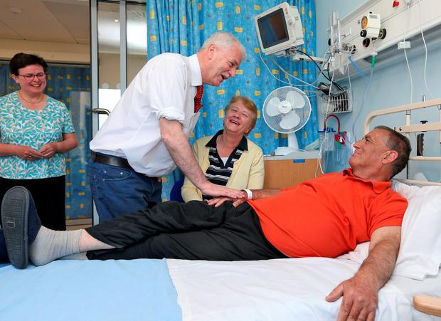 Finian McGrath with kidney transplant patient Philip Mitchell from Swords and his wife Irene at the official opening of the newly refurbished St Damien's Ward at the National Kidney Transplant Centre in Beaumont Hospital yesterday. Photo: Colin Keegan