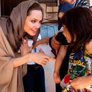 UNHCR Special Envoy Angelina Jolie meets Syrian refugees in the Bekaa Valley, Lebanon, in 2012. Photo: Reuters