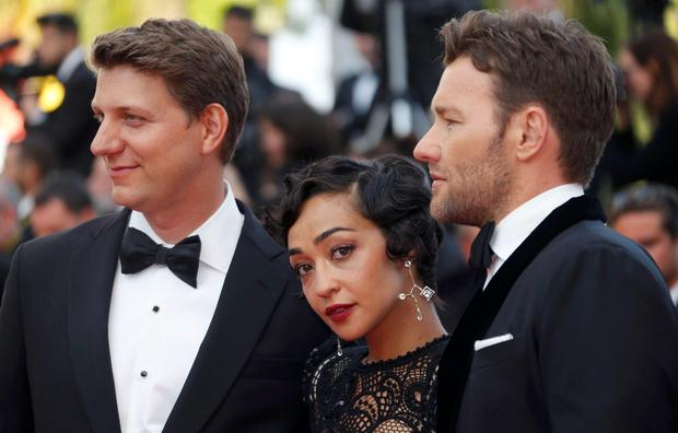 Director Jeff Nichols (L) poses with cast members Joel Edgerton (R) and Ruth Negga as they arrive on the red carpet for the screening of the film