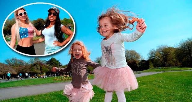 Twin sisters Antonia Wilkowska, left, and Amelia, 4, from Crumlin, Dublin, enjoying the sunshine (Inset: Pamela Cesarini, left, and Yris Vieira, from Portobello, Dublin, enjoying the sunshine) Photo: Caroline Quinn