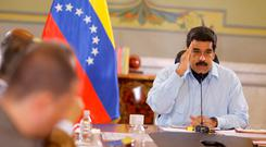 Venezuela's President Nicolas Maduro speaks during a meeting with ministers at the Miraflores Palace in Caracas, Venezuela May 12, 2016