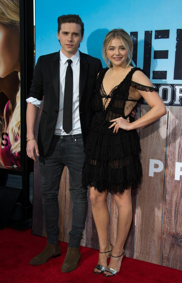 Actress Chloe Grace Moretz (R) and Brooklyn Beckham attend the American Premiere of Universal Pictures