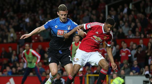 Marcus Rashford competes with Simon Francis (Getty Images)