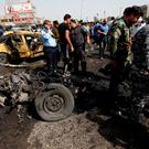 Iraqi security forces and people gather at the site of a car bomb attack in Baghdad's mainly Shi'ite district of Sadr City. Photo: Reuters