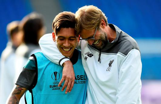 Jurgen Klopp shares a joke with Roberto Firmino ahead of tonight's Europa League final (Reuters)