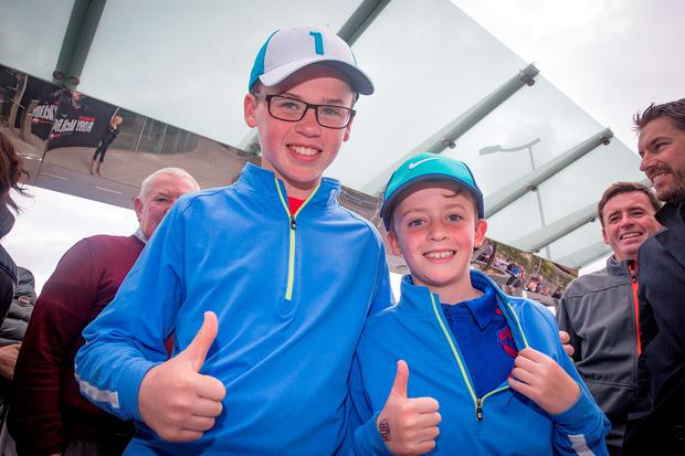 Fans Jack McArdle (14) and his brother Mark (11). Photo: Arthur Carron