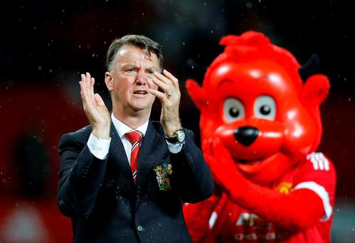 Manchester United manager Louis van Gaal applauds fans during a lap of honour after last night's game Action Images via Reuters / Carl Recine