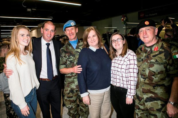 Minister Paul Kehoe Junior Minister for Defence pictured with 51th Infantry Group Commanding Officer Lt Col Brendan Mc Guinness and his wife Dymhna and daughters Alex and Jean and Deputy Chief of Staff Maj Gen Kieran Brennan (right) in Dublin Airport after the 51th Infantry Group returned after spending 6 Months on a UNIFIL Tour in the Lebanon. Pic Kyran O'Brien