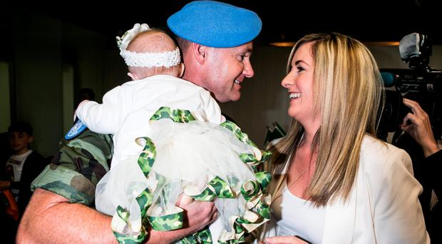 Pte Thomas Grant meets his 10 Week old Daughter Sophia Grace for the first time with his partner Sinead Brennan in Dublin Airport after the 51th Infantry Group returned after spending 6 Months on a UNIFIL Tour in the Lebanon. Pic Kyran O'Brien