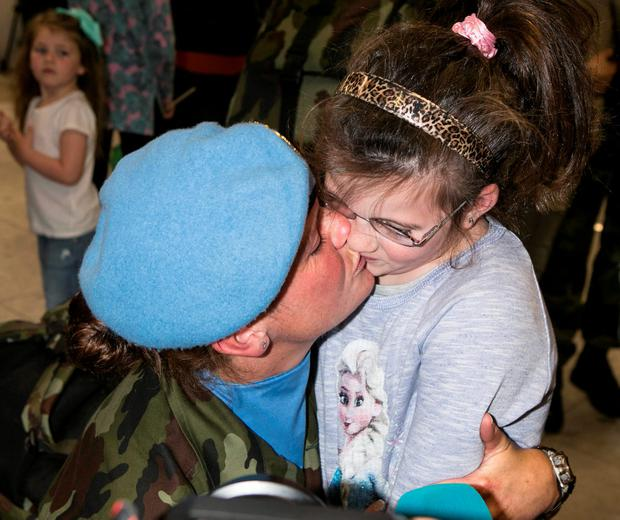 Private Michelle Tarpey with her daughter Grace in Dublin Airport after the 51th Infantry Group returned after spending 6 Months on a UNIFIL Tour in the Lebanon. Pic Kyran O'Brien