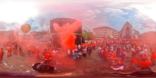 Liverpool fans light flares as they enjoy the atmosphere and sunshine at Barfuesserplatz in the city centre prior to the UEFA Europa League Final match between Liverpool and Sevilla at St. Jakob-Park on May 18, 2016 in Basel, Switzerland