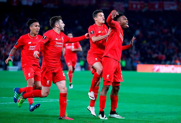 Daniel Sturridge (1st R) of Liverpool celebrates scoring his team's first goal with his team mates Roberto Firmino (1st L), Adam Lallana (2nd L) and Philippe Coutinho (2nd R)