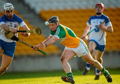 Sean Ryan, Offaly, in action against Shane Fives, Waterford (Photo: Sportsfile)