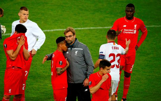 Liverpool's coach Jurgen Klopp consoles his players after Europa Cup defeat