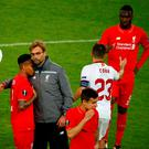 Liverpool's coach Juergen Klopp and players after the match
