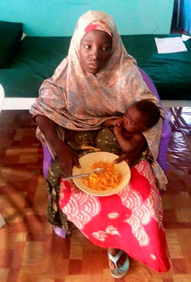 A photo released by Nigeria's army of the rescued Chibok schoolgirl and her baby Photo: Nigeria Military/Handout via REUTERS