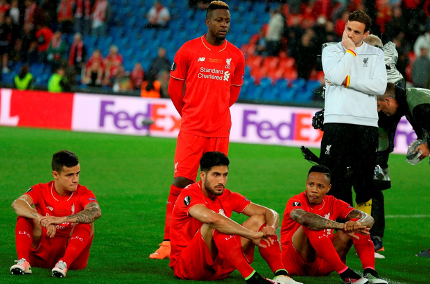 Liverpool players look dejected after the UEFA Europa League Final at St. Jakob-Park, Basel, Switzerland. PRESS ASSOCIATION