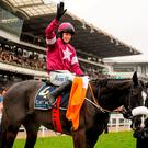 Bryan Cooper celebrates after winning the Timico Cheltenham Gold Cup on Don Cossack with groom Louise Dunne alongside (SPORTSFILE)