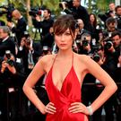 """US model Bella Hadid poses as she arrives on May 18, 2016 for the screening of the film """"The Unknown Girl (La Fille Inconnue)"""" at the 69th Cannes Film Festival"""