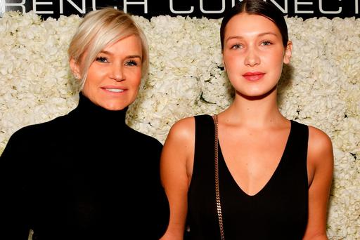 Bella Hadid (pictured with mother Yolanda Foster) favours a fresh-faced look. (Photo by JP Yim/Getty Images)