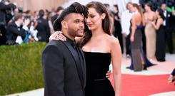 The Weeknd (L) and Bella Hadid attend the