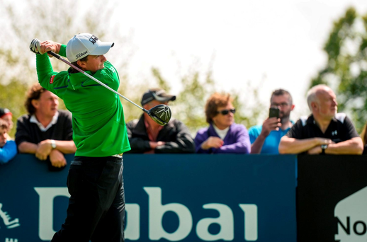 19 May 2016; Paul Dunne of Ireland watches his tee shot on the 5th hole during day one of the Dubai Duty Free Irish Open Golf Championship at The K Club in Straffan, Co. Kildare. Photo by Diarmuid Greene/Sportsfile