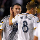 Robbie Keane and Steven Gerrard. (AP Photo/Mark J. Terrill)